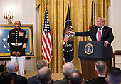 Credit: Chip Somodevilla / Pool via CNPUnited States President Donald J. Trump awards the Medal of Honor to Sergeant Major John L. Canley, United States Marine Corps (Retired), for conspicuous gallantry during the Vietnam War in a ceremony in the East Room of the the White House in Washington, DC on Wednesday, October 17, 2018.<br /> Credit: Ron Sachs / CNP