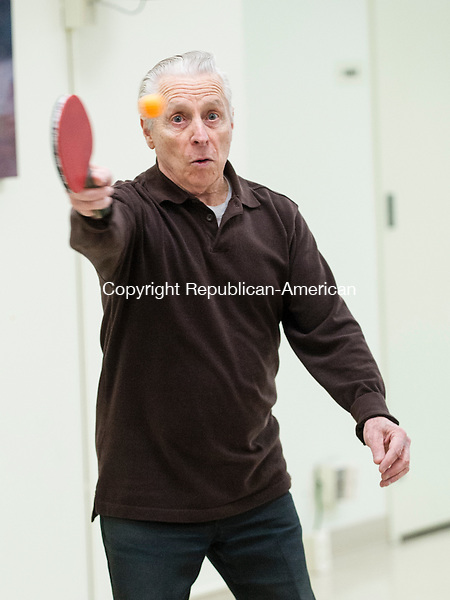 SOUTHBURY, CT-6 January 2015-010615EC03-  Joe Cutrona get scompetitive as he plays table tennis at the Southbury Senior Center Tuesday afternoon. Many of the Southbury seniors, including Cutrona, practice seriously. They are preparing for the Connecticut Masters' Games in April. This year the annual Table Tennis Tournament is in Hartford. Players from all over the state will convene at the Pratt & Whitney gymnasium. Erin Covey Republican-American