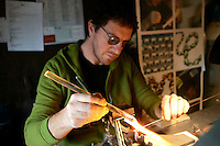 Davide Penso al lavoro nel suo laboratorio di gioielli in vetro, a Murano, Laguna di Venezia.<br /> Glass jewelry designer Davide Penso works in his  laboratory shop in Murano, Venice's Lagoon.<br /> UPDATE IMAGES PRESS/Riccardo De Luca