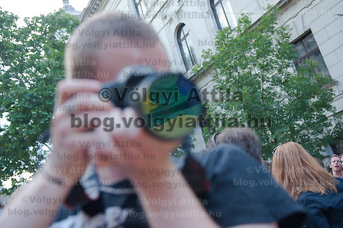 Rainbow flag of the Gay Pride March is reflected on the lens of the camera of a photographer in Budapest, Hungary on June 18, 2011. ATTILA VOLGYI