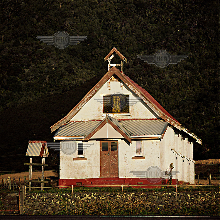 A somewhat dilapidated roadside church with traditional modernist Maori architectural influences at a rural Ngati Porou East Coast tribal community.