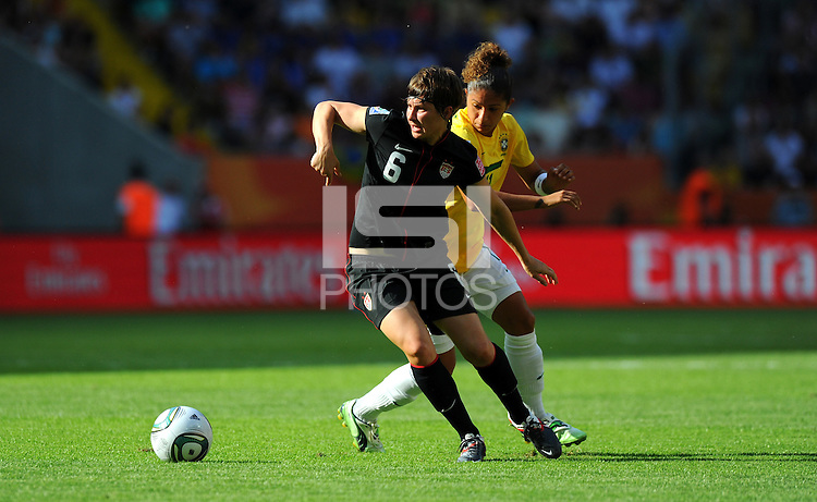 Amy Le Peilbet (l) of team USA and Cristiane of team Brazil during the FIFA Women's World Cup at the FIFA Stadium in Dresden, Germany on July 10th, 2011.