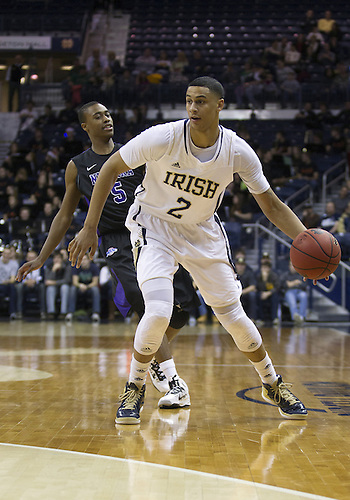 December 21, 2012:  Notre Dame forward Zach Auguste (2) dribbles the ball as Niagara guard Tahjere McCall (5) defends during NCAA Basketball game action between the Notre Dame Fighting Irish and the Niagara Purple Eagles at Purcell Pavilion at the Joyce Center in South Bend, Indiana.  Notre Dame defeated Niagara 89-67.