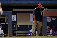 "Akron RubberDucks Athletic trainer Bobby Ruiz during an Eastern League game against the Erie SeaWolves on August 30, 2019 at Canal Park in Akron, Ohio.  Akron wore special jerseys with the slogan ""Fight Like a Kid"" during the game for Akron Children's Hospital Home Run for Life event, the design was created by 11 year old Macy Carmichael.  Erie defeated Akron 3-2.  (Mike Janes/Four Seam Images)"