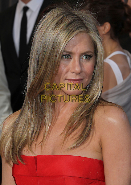 Jennifer Aniston.85th Annual Academy Awards held at the Dolby Theatre at Hollywood & Highland Center, Hollywood, California, USA..February 24th, 2013.oscars headshot portrait red strapless  .CAP/ADM/SLP/COL.©Colin/StarlitePics/AdMedia/Capital Pictures