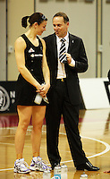 NZ prime minister John Key discusses his tie with Maree Bowden during the International  Netball Series match between the NZ Silver Ferns and World 7 at TSB Bank Arena, Wellington, New Zealand on Monday, 24 August 2009. Photo: Dave Lintott / lintottphoto.co.nz
