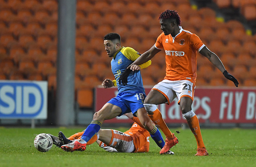 Blackpool's Armand Gnanduillet battles with Solihull Moors' Jordan Murphy<br /> <br /> Photographer Dave Howarth/CameraSport<br /> <br /> The Emirates FA Cup Second Round Replay - Blackpool v Solihull Moors - Tuesday 18th December 2018 - Bloomfield Road - Blackpool<br />  <br /> World Copyright © 2018 CameraSport. All rights reserved. 43 Linden Ave. Countesthorpe. Leicester. England. LE8 5PG - Tel: +44 (0) 116 277 4147 - admin@camerasport.com - www.camerasport.com