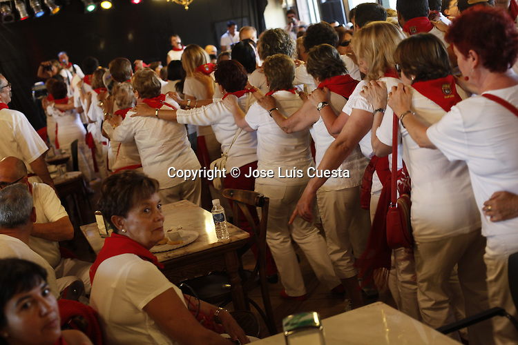"""The """"Alpargata"""" dance is a traditional celebration that have place at Casino after every running bull, Pamplona, Spain. San Fermin festival is worldwide known because the daily running bulls."""