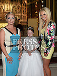 Megan Heeney who received her First Holy Communion in St. Peters Church pictured with mother Michelle and sister Jade. Photo:Colin Bell/pressphotos.ie