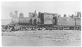 Fireman's-side view of D&amp;RGW locomotive #302 in storage at Alamosa with cab boarded up.<br /> D&amp;RGW  Alamosa, CO  Taken by Maxwell, John W. - 1938