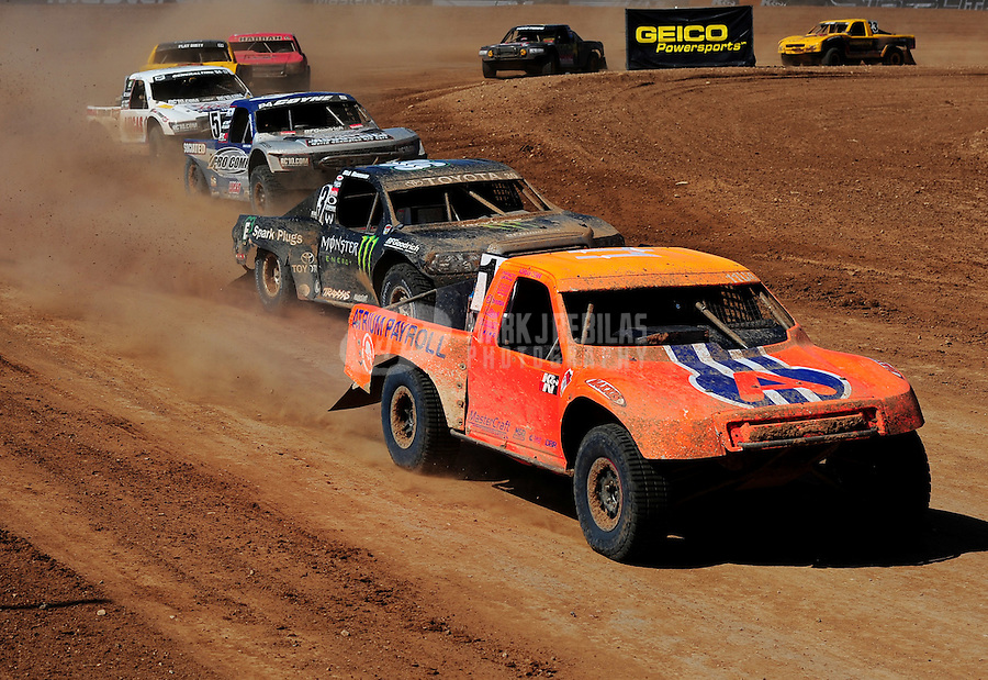 Apr 17, 2011; Surprise, AZ USA; LOORRS driver Adrian Cenni (11) leads Rick Huseman (36) during round 4 at Speedworld Off Road Park. Mandatory Credit: Mark J. Rebilas-