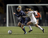 "West Virginia forward Megan Mischler (7) dribbles as Boston College defender Hannah Cerrone (11) closes. Boston College defeated West Virginia, 4-0, in NCAA tournament ""Sweet 16"" match at Newton Soccer Field, Newton, MA."