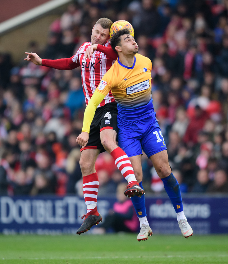 Lincoln City's Michael O'Connor vies for possession with Mansfield Town's Tyler Walker<br /> <br /> Photographer Chris Vaughan/CameraSport<br /> <br /> The EFL Sky Bet League Two - Lincoln City v Mansfield Town - Saturday 24th November 2018 - Sincil Bank - Lincoln<br /> <br /> World Copyright © 2018 CameraSport. All rights reserved. 43 Linden Ave. Countesthorpe. Leicester. England. LE8 5PG - Tel: +44 (0) 116 277 4147 - admin@camerasport.com - www.camerasport.com