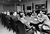 United States Secretary of Defense Donald H. Rumsfeld meets with Senior Reserve Forces Managers in the US Department of Defense, April 14, 1976, in the Pentagon.  Seated at head of the table Foreground) is Secretary Rumsfeld.  Clockwise from his left are: William D. Clark, Deputy Assistant Secretary of Army (Reserve Affairs); Dr. James P. Gilligan, Deputy Assistant Secretary of Air Force (Reserve Affairs); Major General LaVern E. Weber, Chief National Guard Bureau; Major General John J. Pesch, Director, Air National Guard; Major General Charles A. Ott, Jr., Director, Army National Guard; Major General W. Stanford Smith, Military Executive, Reserve Forces Policy Board; Rear Admiral William S. Schwob, Chief, Coast Guard Reserve; Brigadier GeneralEdward Dillon, Deputy Chief, Air Forces Reserve; Major General Michael P. Ryan, Director, Marine Corps Reserve; Major General Henry Mohr, Chief of Army Reserve; Vice Admiral Pierre Charbonnet, Chief of Naval Reserve; Honorable J. Palmer Gaillard, Jr., Deputy Assistant Secretary of Navy (Reserve Affairs); Honorable Will Hill Tankersley, Deputy Assistant Secretary of Defense (Reserve Affairs).<br /> Mandatory Credit: Robert D. Ward / DoD via CNP