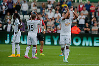 Saturday 20th September 2014  Pictured:  Ashley Williams applauds fans as he leaves at the field after his teams defeat <br /> Re: Barclays Premier League Swansea City v Southampton  at the Liberty Stadium, Swansea, Wales,UK