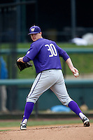 Jared Fisher #30 of the Washington Huskies pitches against the UCLA Bruins at Jackie Robinson Stadium on March 17, 2013 in Los Angeles, California. (Larry Goren/Four Seam Images)