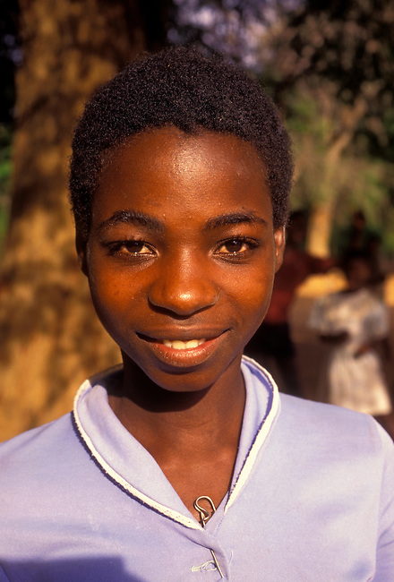 Girl outside of school in village of Mahenye, Manicaland Province, Zimbabwe, Africa