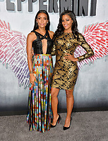 "LOS ANGELES, CA. August 28, 2018: Annie Ilonzeh & Claudia Jordan at the world premiere of ""Peppermint"" at the Regal LA Live."