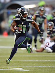 Seattle Seahawks wide receiver Percy Harvin runs after catching an 18-yard pass against the Chicago Bears in  a pre-season game at CenturyLink Field in Seattle, Washington on August 12, 2014.  Seattle beat Chicago 34-6. Harvin caught three passes for 61-yards in the win. © 2014.  Jim Bryant Photo. ALL RIGHTS RESERVED.