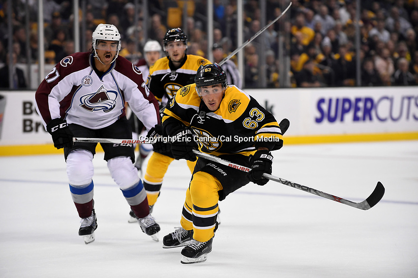 Thursday, November 12, 2015: Boston Bruins left wing Brad Marchand (63) and Colorado Avalanche center Andreas Martinsen (27) chase the puck during the National Hockey League game between the Colorado Avalanche and the Boston Bruins held at TD Garden, in Boston, Massachusetts. Colorado defeats Boston 3-2 in regulation time. Eric Canha/CSM
