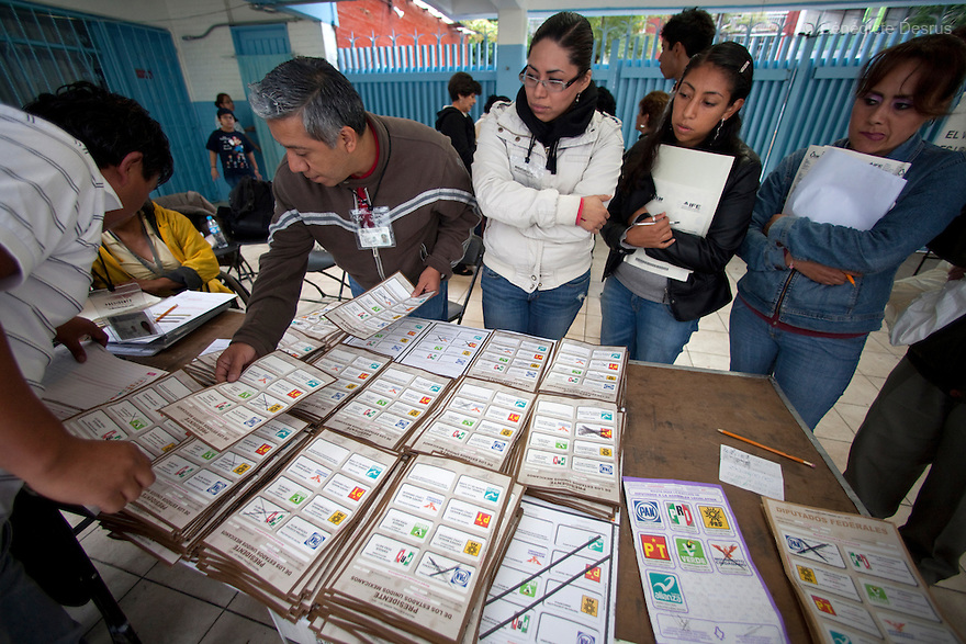 1 July 2012 - Mexico City, Mexico - Election workers count votes during the Mexico general election at a polling station in Mexico City. Mexicans vote for a new president on july 1. Photo credit: Benedicte Desrus