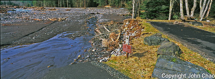 """""""This site can be used by anyone"""" is a sign that remains by where Sunshine Point Campground was washed away by flooding in November 2006, Mount Rainier National Park, Washington State."""