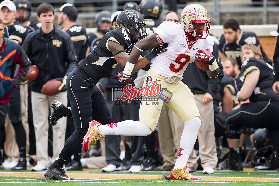 Karlos Williams (9) of the Florida State Seminoles is forced out of bounds by Anthony Wooding Jr. (11) during second half action at BB&T Field on November 9, 2013 in Winston-Salem, North Carolina.  The Seminoles defeated the Demon Deacons 59-3.    (Brian Westerholt/Sports On Film)