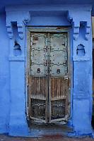 blue door in the streets of Jodhpur,  Rajastan, India
