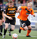 United's Gary Mackay Steven tries to get away from Alloa's Michael Doyle.