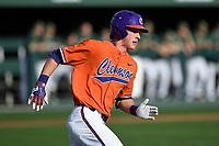 Shortstop Logan Davidson (8) of the Clemson Tigers runs out a batted ball in a game against the William and Mary Tribe on February 16, 2018, at Doug Kingsmore Stadium in Clemson, South Carolina. Clemson won, 5-4 in 10 innings. (Tom Priddy/Four Seam Images)