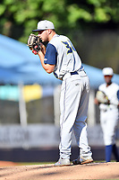 Columbia Fireflies starting pitcher Christian James (30) looks in for the sign during a game against the Asheville Tourists at McCormick Field on June 22, 2019 in Asheville, North Carolina. The Tourists defeated the Fireflies 6-5. (Tony Farlow/Four Seam Images)