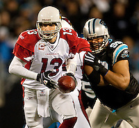 Arizona Cardinals quarterback Kurt Warner (13) prepares to hands the ball off against the Carolina Panthers during the NFC Divisional Playoff football game at Bank of America Stadium, in Charlotte, NC. Arizona defeated the Carolina Panthers 33-13.