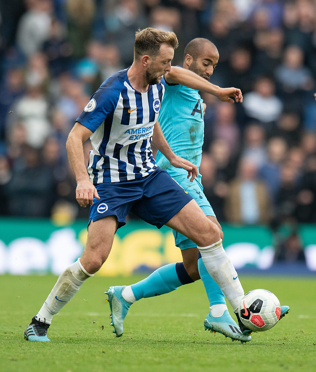 Brighton & Hove Albion's Dale Stephens (left) battles for possession with Tottenham Hotspur's Lucas (right) <br /> <br /> Photographer David Horton/CameraSport<br /> <br /> The Premier League - Brighton and Hove Albion v Tottenham Hotspur - Saturday 5th October 2019 - The Amex Stadium - Brighton<br /> <br /> World Copyright © 2019 CameraSport. All rights reserved. 43 Linden Ave. Countesthorpe. Leicester. England. LE8 5PG - Tel: +44 (0) 116 277 4147 - admin@camerasport.com - www.camerasport.com