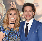 HOLLYWOOD, CA - FEBRUARY 13: Director Richie Keen (R) and actress Brianna Brown attend the premiere of Warner Bros. Pictures' 'Fist Fight' at the Regency Village Theatre on February 13, 2017 in Westwood, California.