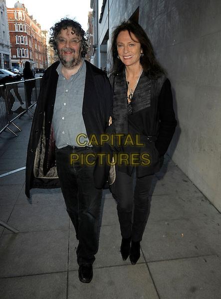 Stephen Poliakoff & Jacqueline Bisset .at BBC Radio 4,  London, England, .30th January 2013..Full length black coat glasses  walking smiling  bag trousers jacket .CAP/IA.©Ian Allis/Capital Pictures.