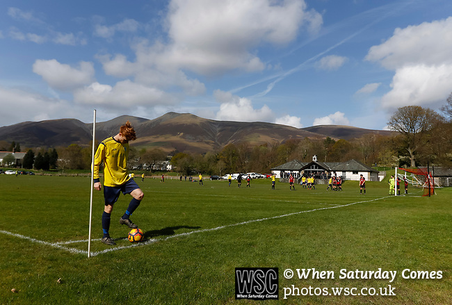 Keswick 1 Kendal 1, 15/04/2017. Fitz Park, Westmoreland League. The Kendal left back prepares to take a corner. Photo by Paul Thompson.