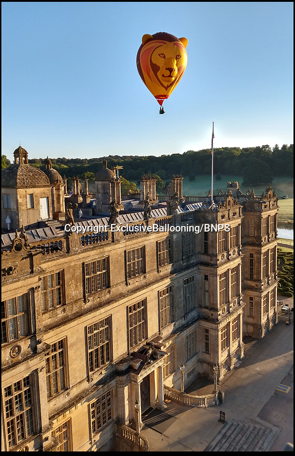BNPS.co.uk (01202 558833)Pic : ExclusiveBallooning/Longleat/BNPS<br /> Big Game...Stunning 'Sky Safari' launches at Longleat house today.<br /> <br /> The stunning sight of a 6 animal themed hot air balloons taking gracefully to the air in front of Longleat House in Wiltshire this morning.<br /> <br /> This weekend a massiive balloon festival with 220 colourful balloons from all over the world will take to the air.<br /> <br /> Organisers are hoping to set a new British record with 150 inflatables in the air simmultaneously.
