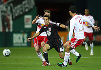 Josh Wolfe (16) of D.C. United gets past Teemu Tainio (2) and Rafa Marquez (4) of the New York Red Bulls during an MLS match at RFK Stadium, in Washington D.C. on April 21 2011. Red Bulls won 4-0.