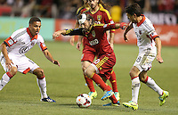 Ned Grabavoy (c) of Real Salt Lake moves the ball between Luis Silva (l) and John Thorrington #8 of D.C. United during the second half of the U.S. Open Cup Final on October  1, 2013 at Rio Tinto Stadium in Sandy, Utah. DC United beat Real Salt Lake 1-0 to win the championship.