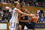 02 January 2012: Virginia's Simone Egwu (4) is defended by Duke's Tricia Liston (left). The Duke University Blue Devils defeated the University of Virginia Cavaliers 77-66 at Cameron Indoor Stadium in Durham, North Carolina in an NCAA Division I Women's basketball game.