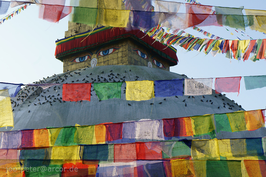 colorul Buddhist mantra prayer flags in front of Boudha stupa in Kathmandu, Boudhanath,  Nepal