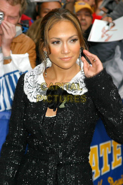 JENNIFER LOPEZ.Arrives for the David Letterman Show in New York City, USA, October 13th 2004.half length black tweed jacket coat black rose flower corsage white lace collar.Ref: IW.www.capitalpictures.com.sales@capitalpictures.com.©Capital Pictures.