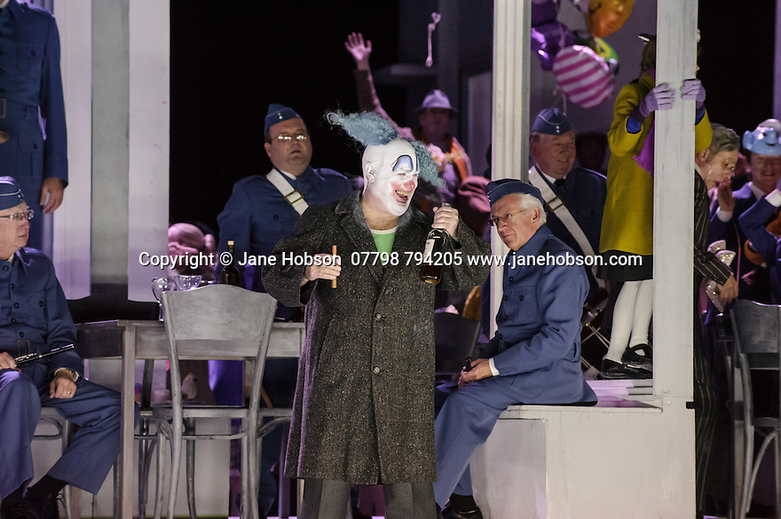 English National Opera presents, in a co-production with Dutch National Opera, Amsterdam, Puccini's LA BOHEME, at the London Coliseum. Picture shows: Murray Kimmins (Parpignon, a Toy Seller) and the company.