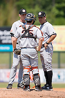 Hagerstown Suns pitching coach Paul Menhart (48) chats with catcher Sean Rooney (25) and Starting pitcher Colton Willems (28) at Fieldcrest Cannon Stadium in Kannapolis, NC, Monday May 26, 2008.