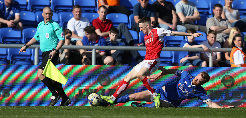 Fleetwood Town's Ashley Hunter is tackled by Oldham Athletic's Chris Taylor<br /> <br /> Photographer Stephen White/CameraSport<br /> <br /> The EFL Sky Bet League One - Oldham Athletic v Fleetwood Town - Saturday 8th April 2017 - SportsDirect.com Park - Oldham<br /> <br /> World Copyright &copy; 2017 CameraSport. All rights reserved. 43 Linden Ave. Countesthorpe. Leicester. England. LE8 5PG - Tel: +44 (0) 116 277 4147 - admin@camerasport.com - www.camerasport.com