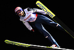 Andreas Kofler of Austria soars through the night sky in the the normal hill individual jump event at the Nordic Skiing World Championships in Sapporo, Japan in March, 2007