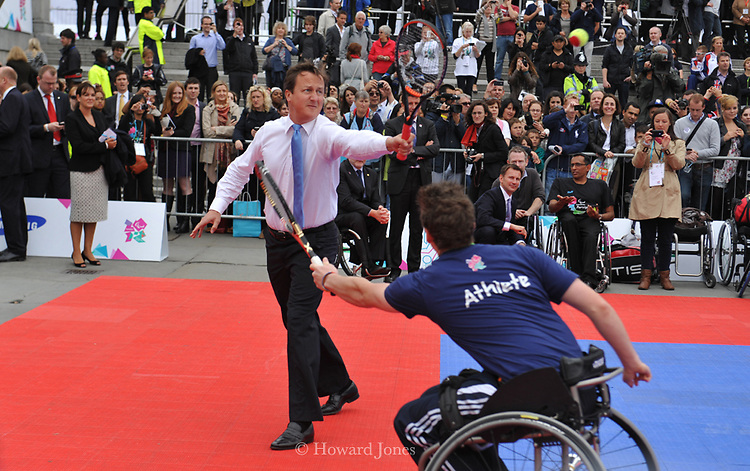 Prime Minister David Cameron in tennis match with paralympic  athlete to promote promote International Paralympic Day.London. 8th September 2011