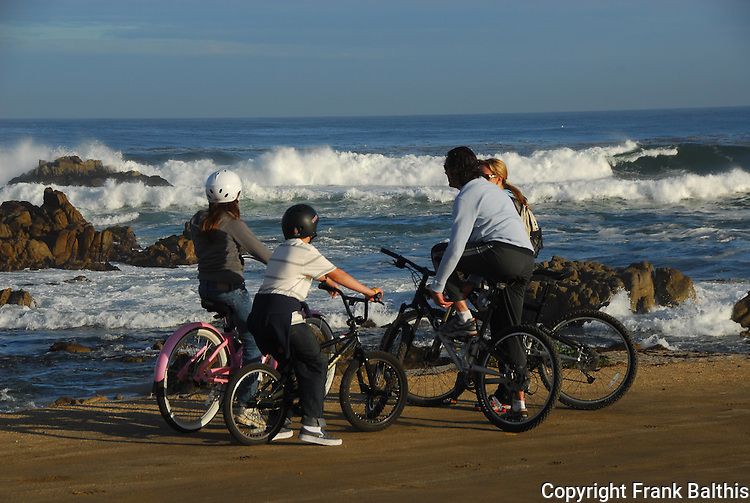 family riding bicycles at Asilomar State Beach in Pacific Grove