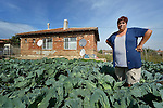 Gulten Murat stands in her garden in a largely Roma, Turkish-speaking neighborhood of Dobrich, in the northeast of Bulgaria. Part of the produce from her garden is used in a child feeding program sponsored by the local United Methodist congregation.