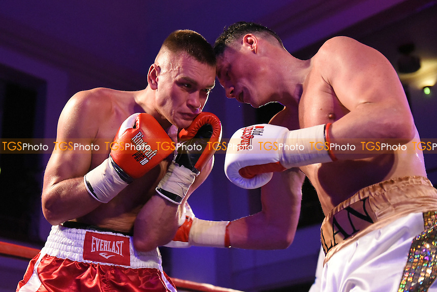Alan Higgins (gold/white shorts) defeats Edgars Sniezde during a Boxing Show at the Camden Centre, Euston Road, England on 04/12/2015